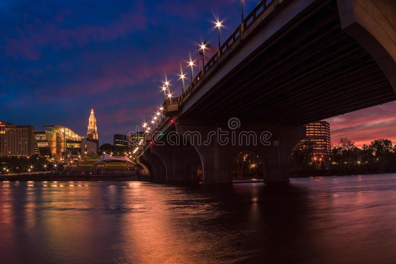 Hartford connecticut at dusk beautiful cityscape and sunset. Scene from founders bridge east hartford connecticut leading to downtown evening sunset colourful royalty free stock images