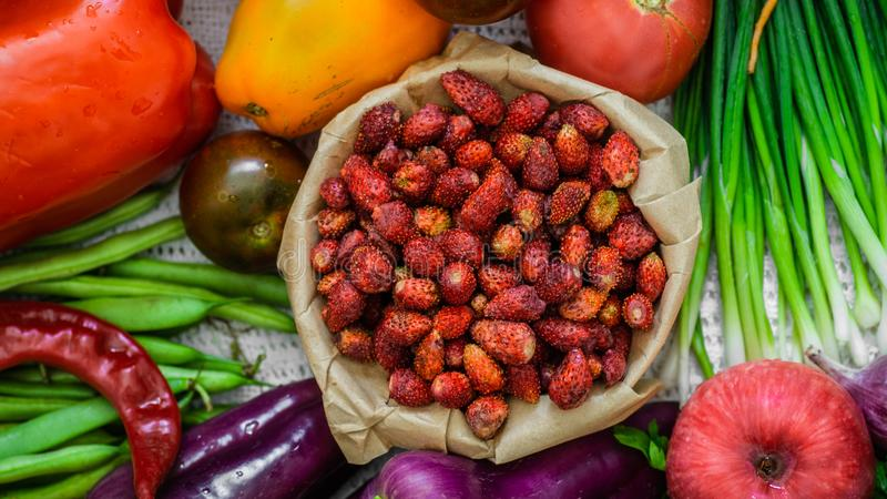 Harvest, Autumn. Fresh healthy fruits and vegetables. Healthy eating background. Red Strawberries in the hands of men closeup. Harvest, Autumn. Panoramic royalty free stock photography