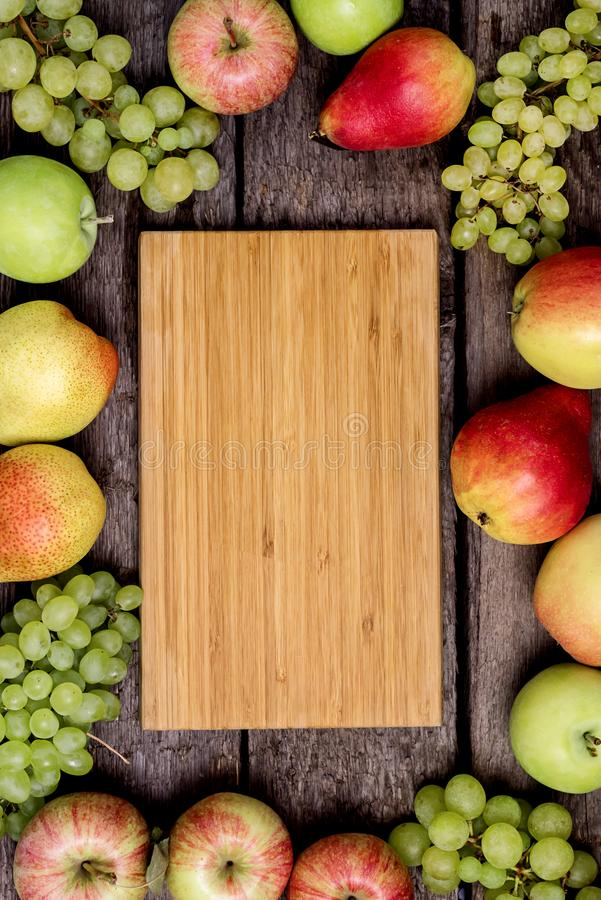 Harvest Background Harvest Concept Autumn Wooden Background with Fruits Apples Pears and Green Grapes Horizontal Copy Space Place. For Text Top View Flat Lay stock image