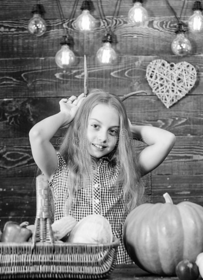 Harvest festival concept. Child little girl enjoy farm life. Organic gardening. Kid farmer with harvest wooden. Background. Grow your own organic food. Girl kid stock images