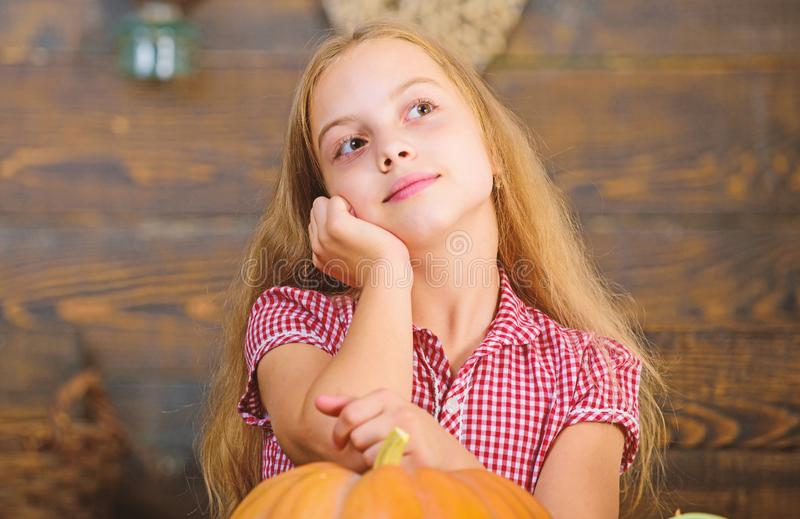 Harvest festival concept. Girl kid at farm market with organic vegetables. Grow your own organic food. Kid farmer with. Harvest wooden background. Child little royalty free stock photography