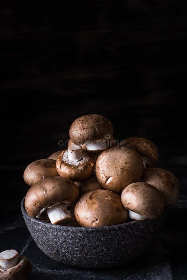 Harvest of mushrooms in plate. Selective focus. Royal champignon. Vegan. Vegetarian food, Vitamin. Healthy food. Process of stock photo