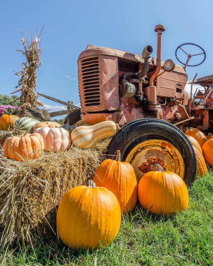 Harvest time. An old tractor decorated with fall harvest items royalty free stock images