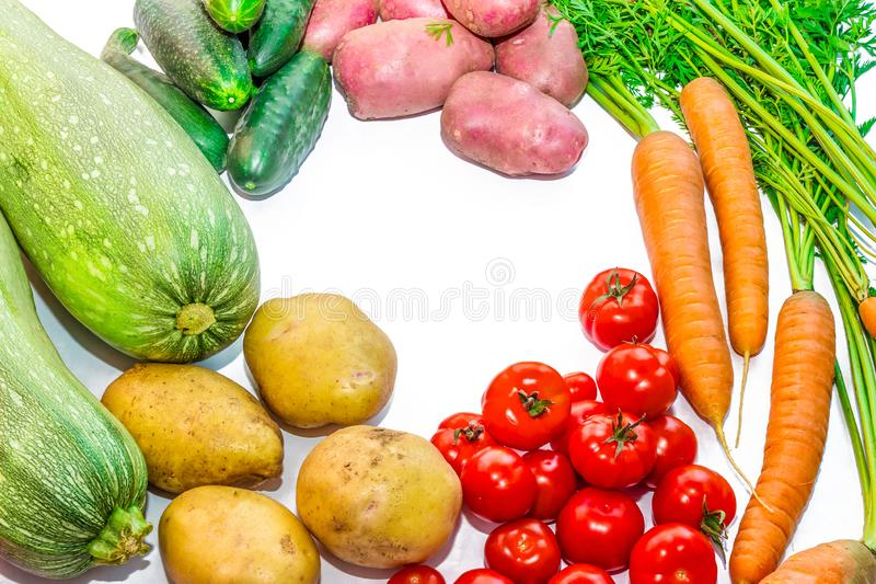 Harvest vegetables on a white background. Potatoes, carrots, tom stock image