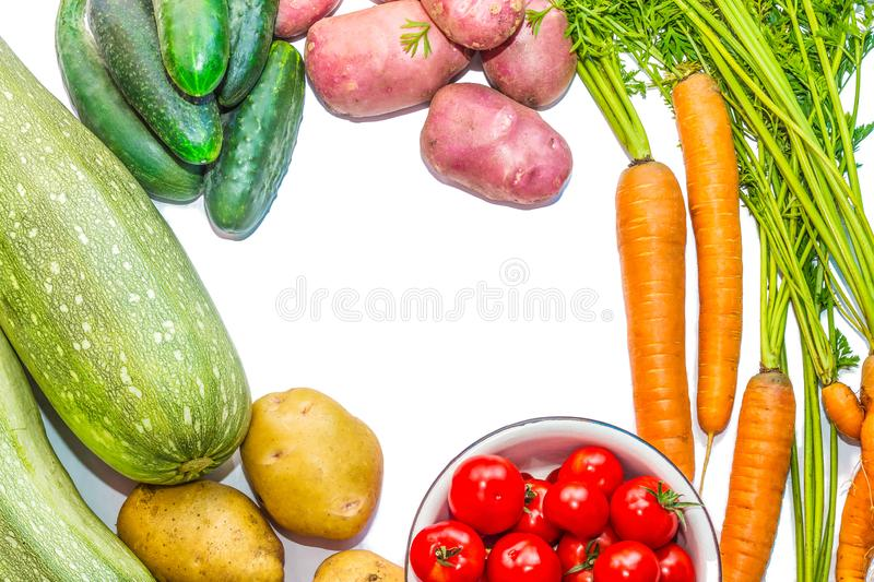 Harvest vegetables on a white background. Potatoes, carrots, tom royalty free stock image