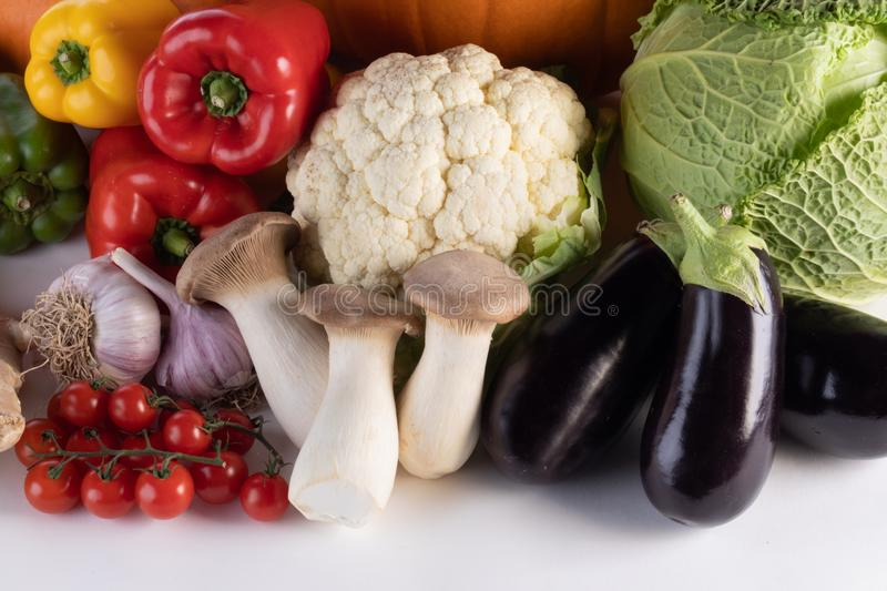 Harvest on white background. Harvest of many vegetables isolated on white background border frame with copy space for text stock photography