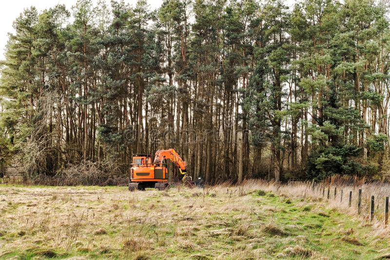 Harvester car doing forestry work at Loch Leven, Scotland.  royalty free stock photography