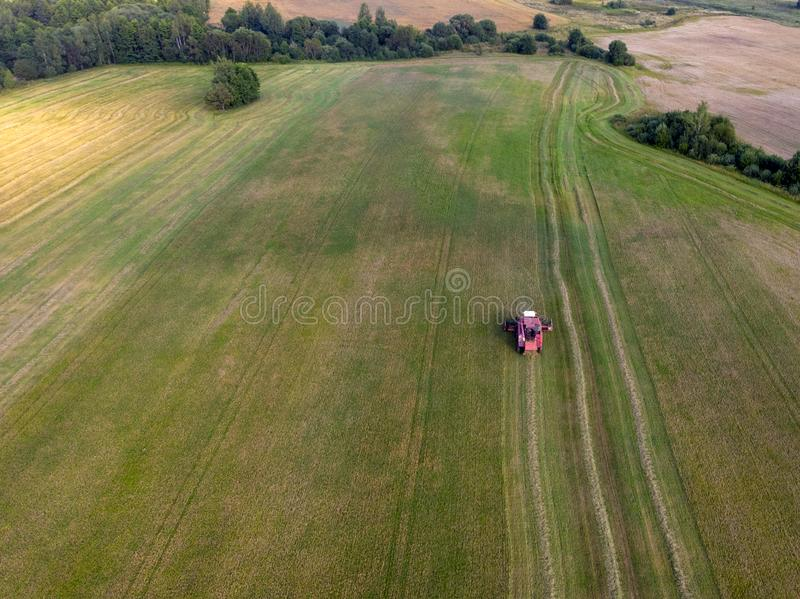 Harvester machine working in field . Combine harvester agriculture machine harvesting golden ripe wheat field. royalty free stock photos
