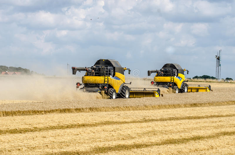 Combines harvesting field royalty free stock photos