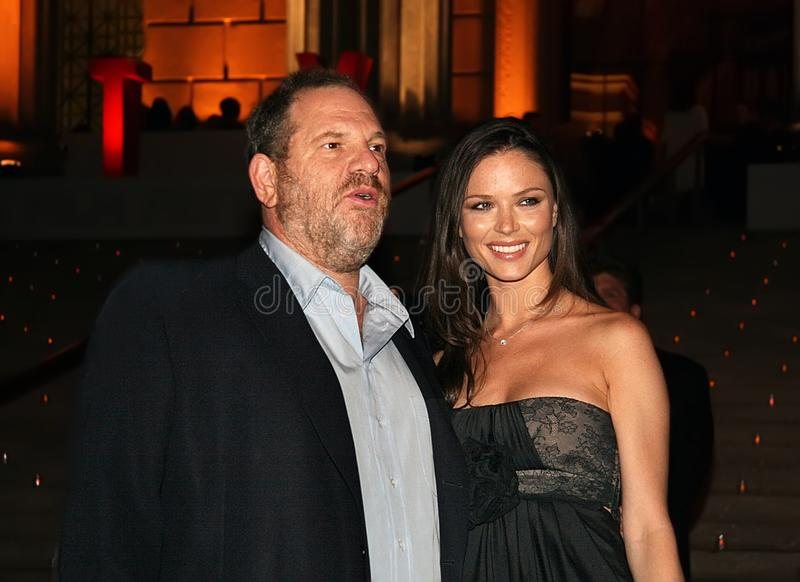Harvey Weinstein and Georgina Chapman. Producer Harvey Weinstein and then girlfriend, English fashion designer, Georgina Chapman, arrive at the Vanity Fair party royalty free stock photos
