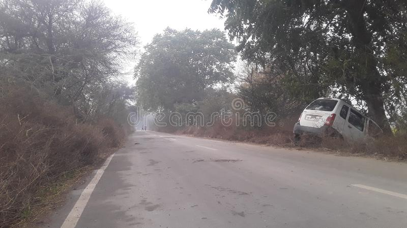 Haryana India in village retreat Road in accident. Haryana India in village shareit Road in accident in summer cool and rain season and unfinished Road stock image