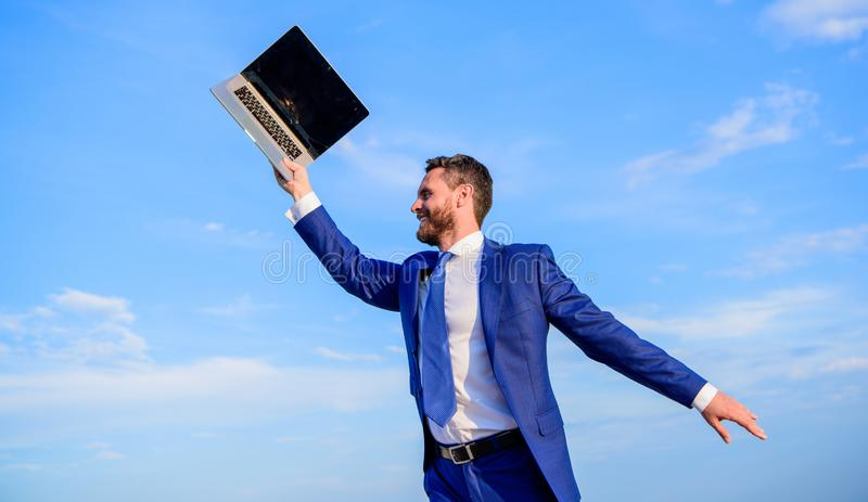 He has a dream. Man inspired holds laptop above himself. Businessman inspired entrepreneur feels powerful going to royalty free stock photo