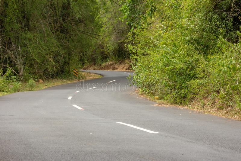 Beautiful Ghat road along the mountain range of Talamalai Reserve Forest, Hasanur, Tamil Nadu - Karnataka State border, India. Hasanur is a town in Talamalai stock photo