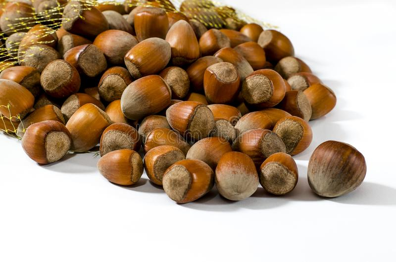 haselnüße Lebensmittelhintergrund, Fototapete Nussmakro lizenzfreie stockfotografie