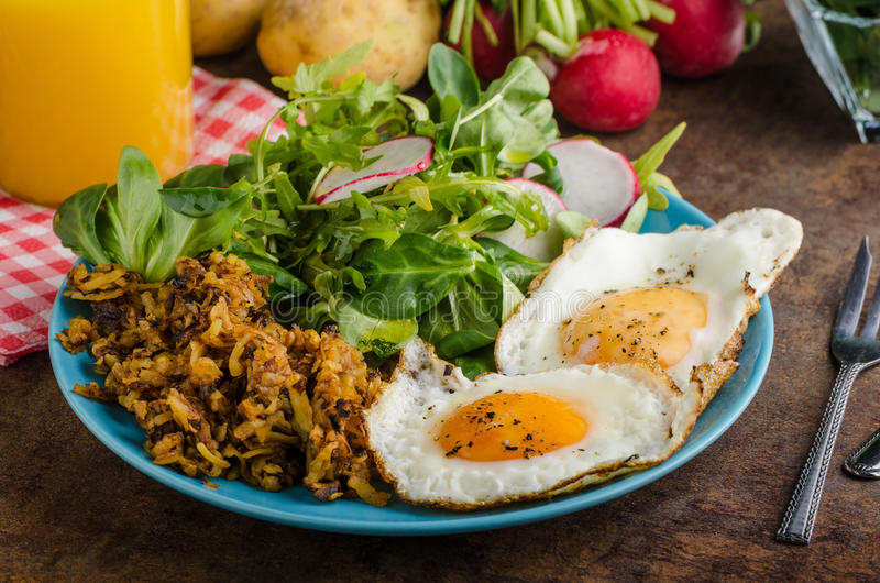 Hash Browns potato with eggs royalty free stock photography