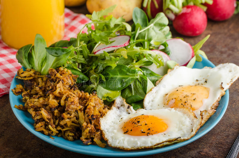 Hash Browns potato with eggs stock photography