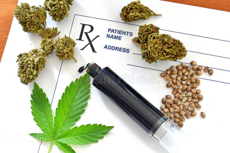 Hash oil with medical cannabis, cannabis seeds and prescription stock photo