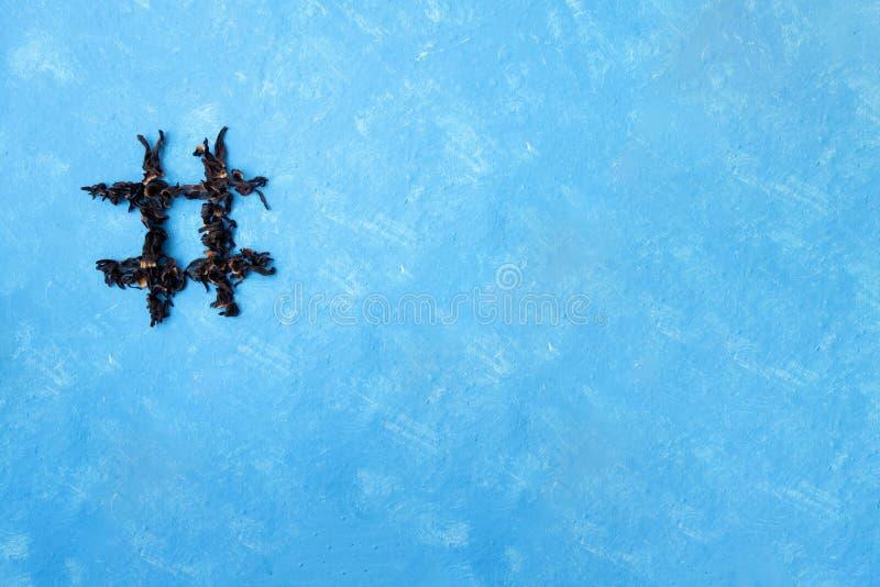 Hashtag de ketmie de thé sur un fond de bluee Typographie de nourriture ?l?ment de conception image stock
