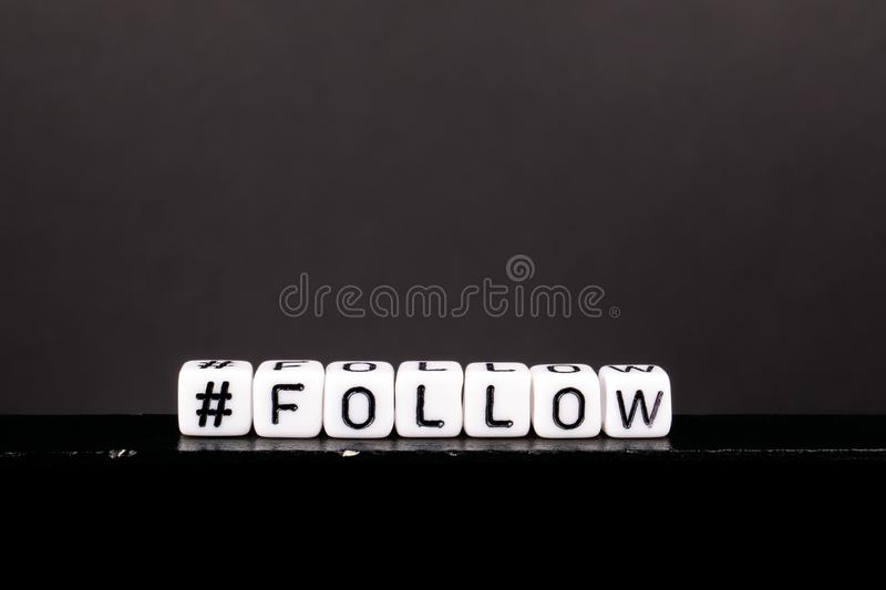 Hashtag med ord följer royaltyfri fotografi