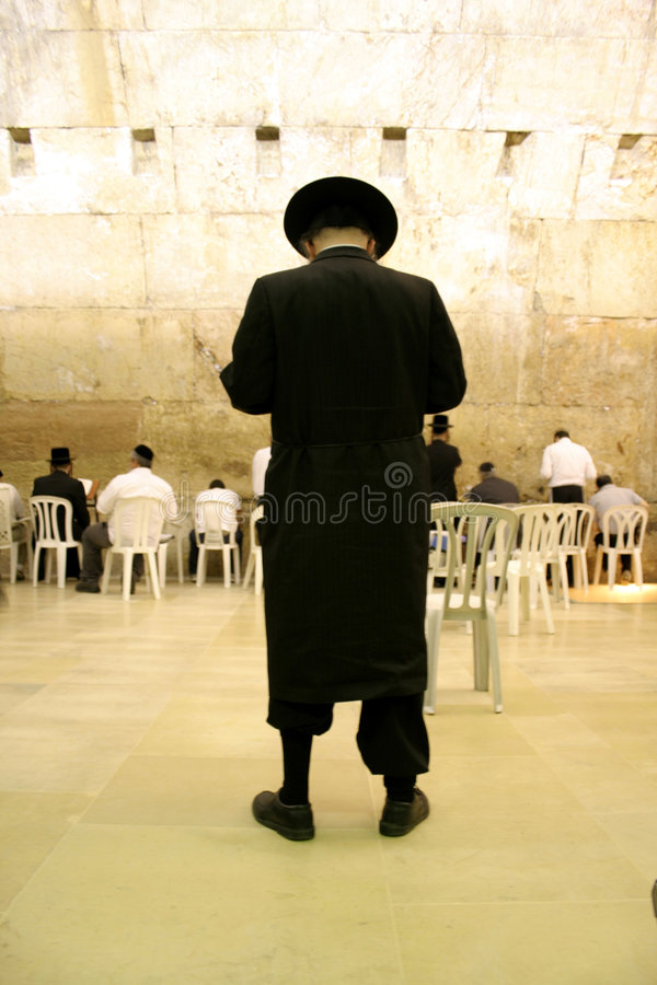 Hasidic jews by wailing wall. Hasidic jews at the wailing western wall, jerusalem, israel royalty free stock image