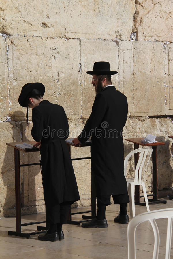 Hasidic Jews at the Western wall. Prayer Orthodox Hasidic Jews (father and son) at the Western wall (Wailing Wall). Jerusalem. Israel stock images