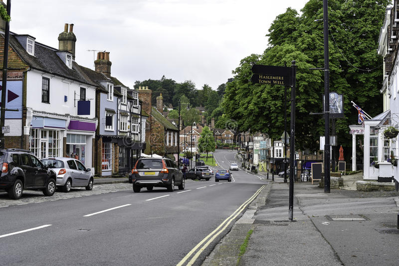 Haslemere Town Centre. Stone haslemere flag monument flower bank road lawn cross memorial shops landmark cars high town retail street bed parking flagpole shop royalty free stock photography