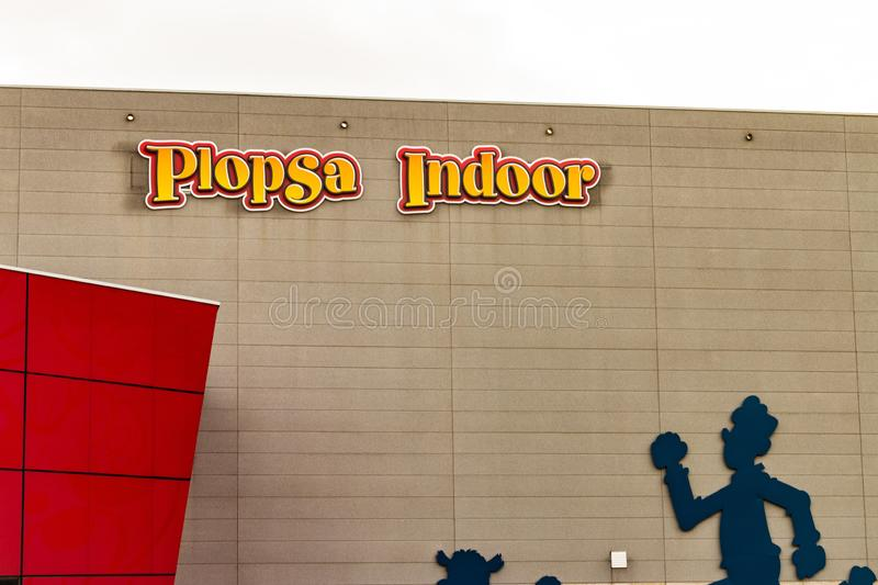 HASSELT, BELGIUM - AUGUST 8 2018: Logo of Plopsa Indoor in Hasselt Belgium on the outside of the building where many children can. Have fun in this indoor theme royalty free stock photos