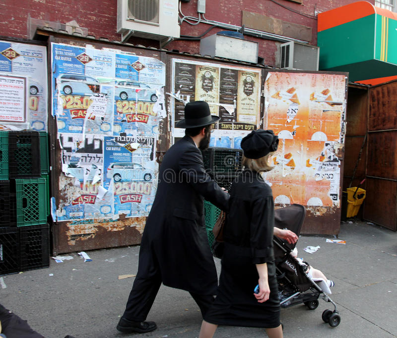 Hassidic Jews in Brooklyn. The Williamsburg area of Brooklyn is an enclave of Hassidic Jews who dress in traditional clothing, and many of the outdoor stock photos
