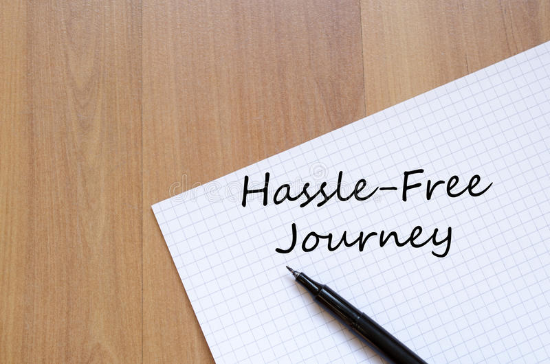 Hassle free journey write on notebook. Hassle free journey text concept write on notebook with pen stock images