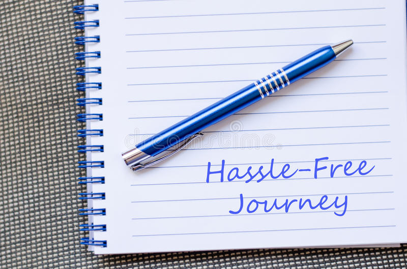 Hassle free journey write on notebook. Hassle free journey text concept write on notebook with pen stock photos