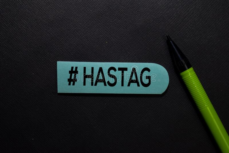 #Hastags write on a sticky note isolated on office desk royalty free stock photos