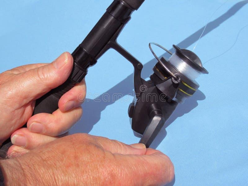Haste e carretel de pesca imagem de stock