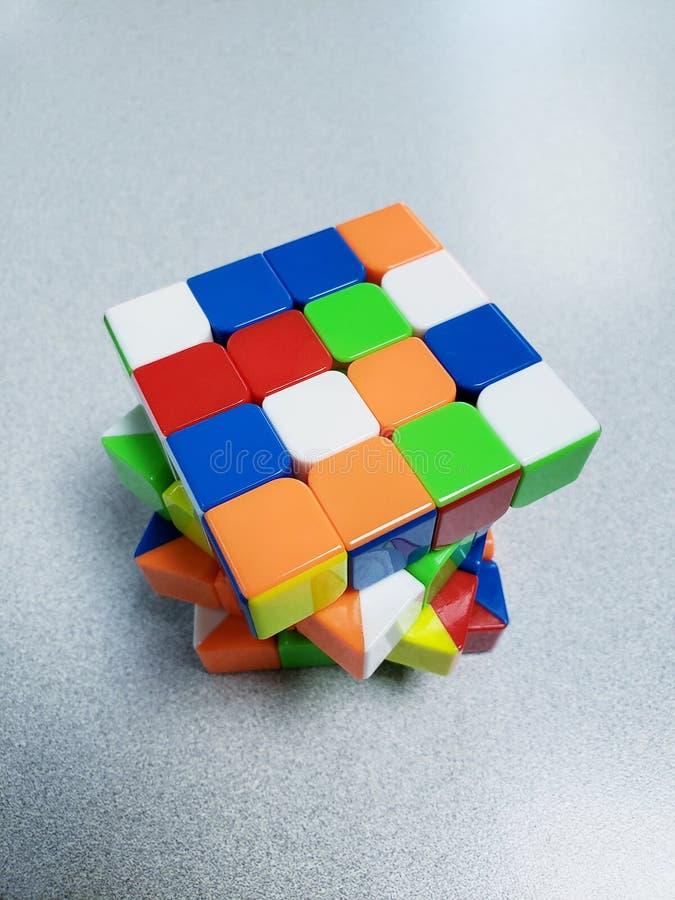 hastighetskub Stickerless för 4x4x4 Rubiks arkivbild