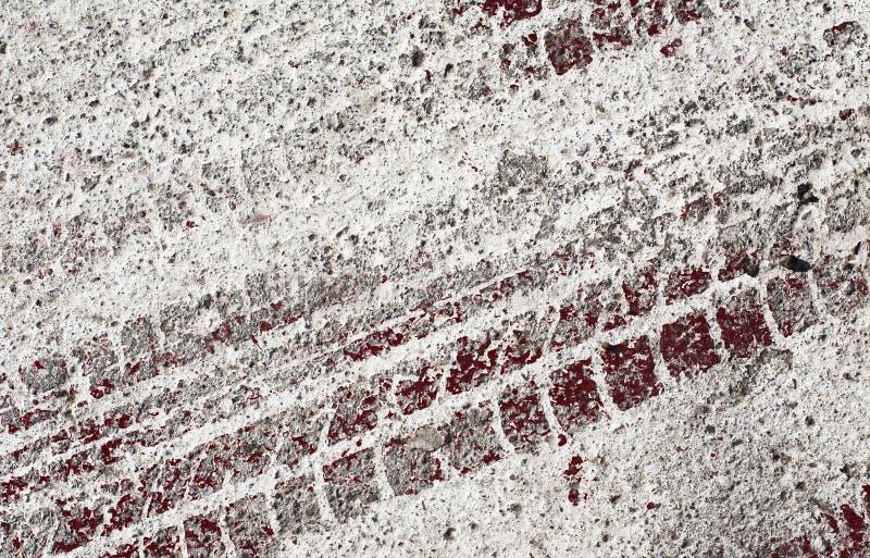 Hastighetsloppspår på en asfalt arkivfoto