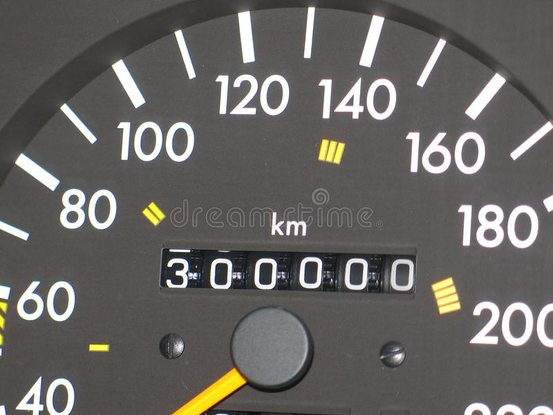 Hastighetsmätare 300 000 km royaltyfri foto
