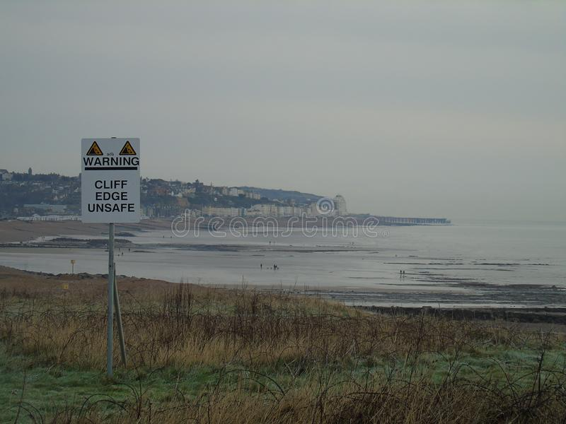 Hastings seafront view with warning sign royalty free stock image