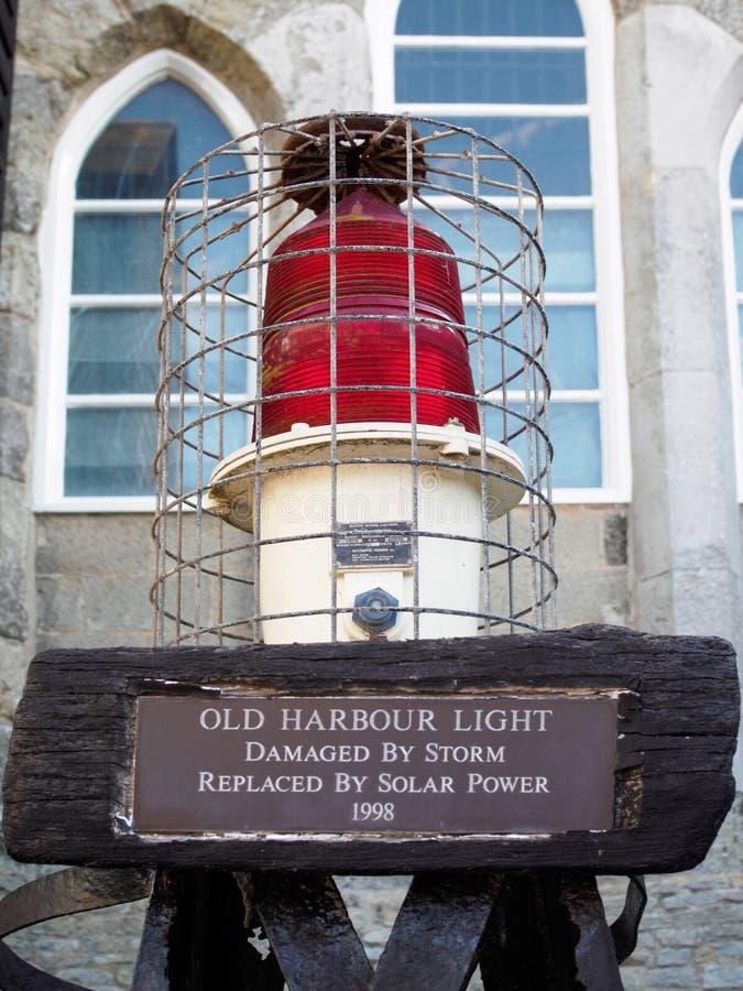 HASTINGS, SUSSEX/UK DEL ESTE - 6 DE NOVIEMBRE: Vieja luz Damag del puerto foto de archivo libre de regalías