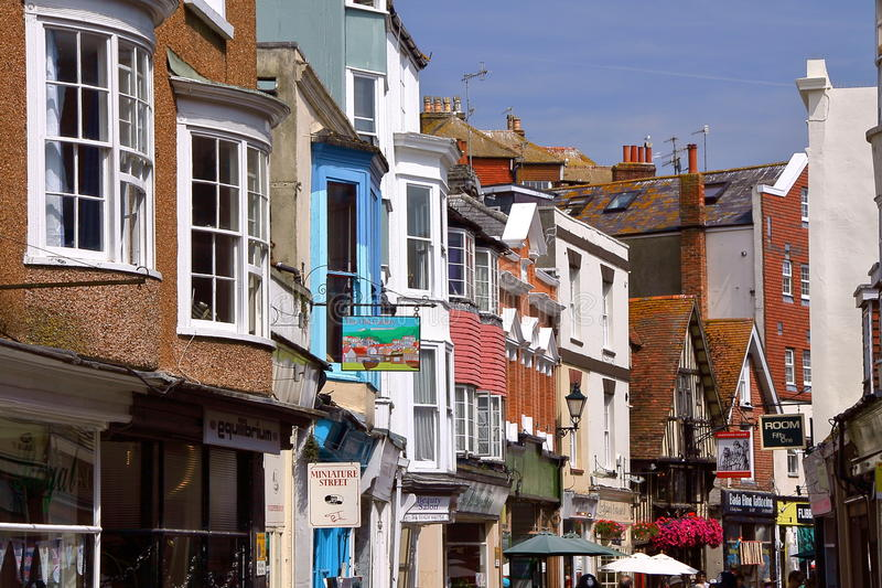 HASTINGS, UK - JULY 31, 2011: The popular and commercial street George Street with Ye Olde Pump House Pub and colorful houses. The popular and commercial street royalty free stock photography