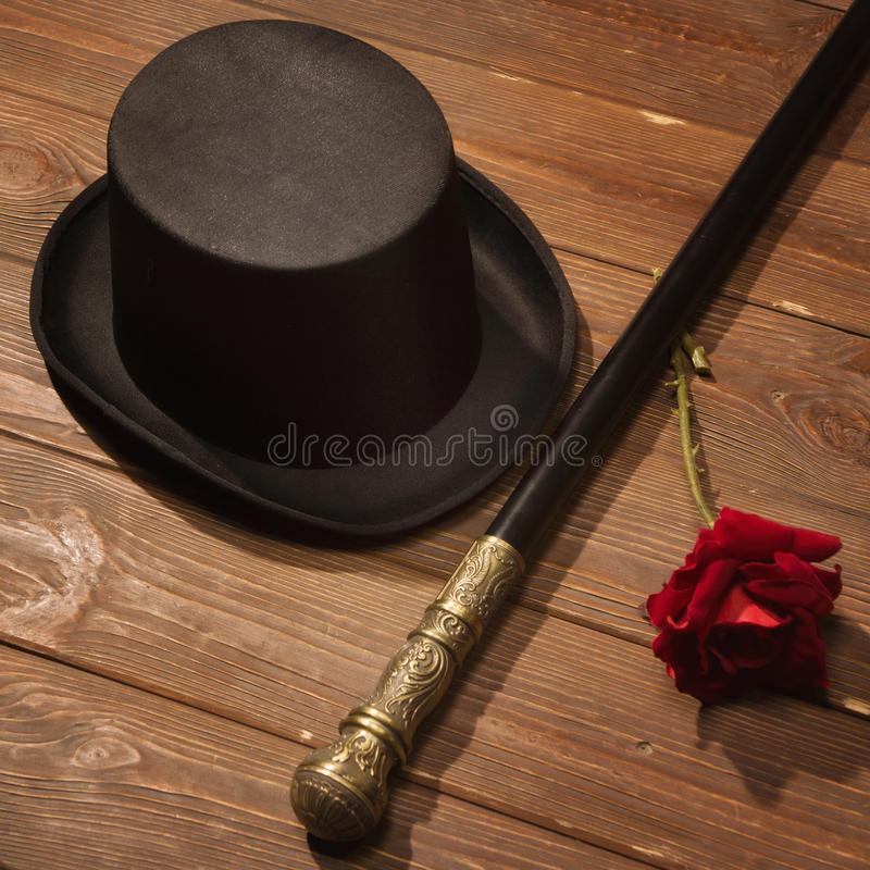 Hat, cane and rose stock photos