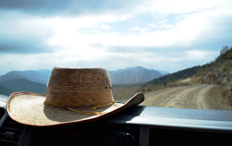 Hat on the dashboard inside a car. While on a roadtrip exploring the countryside outside of Oaxaca, Mexico royalty free stock photo