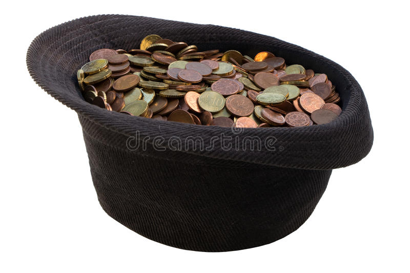 Hat with donated money royalty free stock image