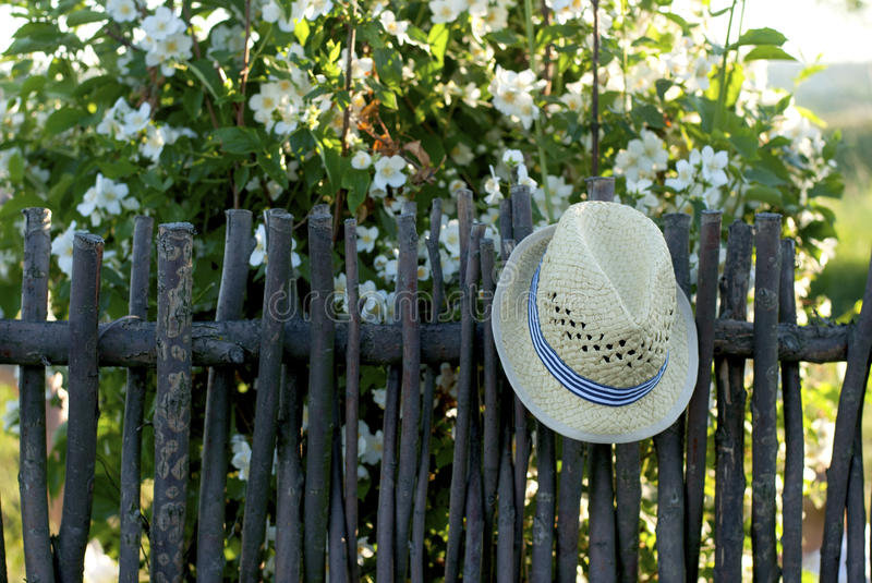 Hat on a fence royalty free stock photography
