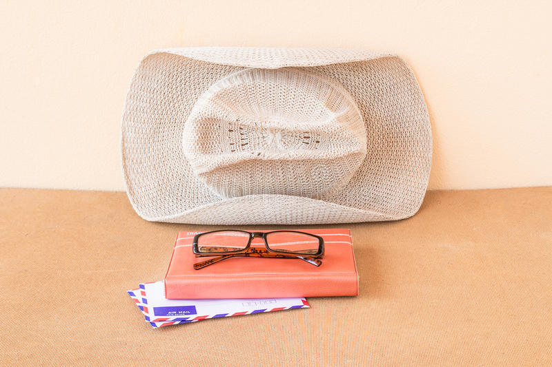 Hat,notebook, glasses and envelope on a wood background royalty free stock photos