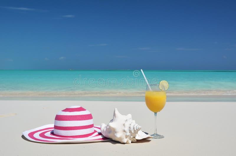 Hat and orange juice royalty free stock image