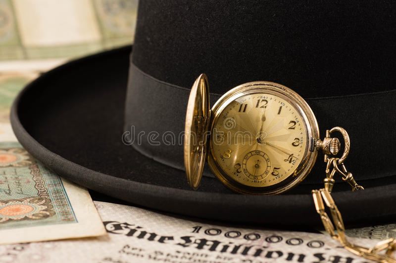Hat with pocket watch stock images