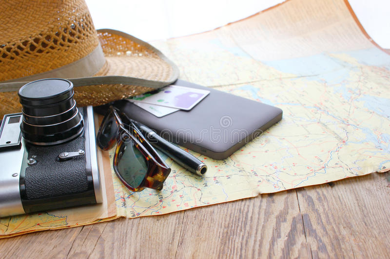 The hat and retro photo camera on white background. The Journey road accesories.Ball point pen ,wooden table royalty free stock photo