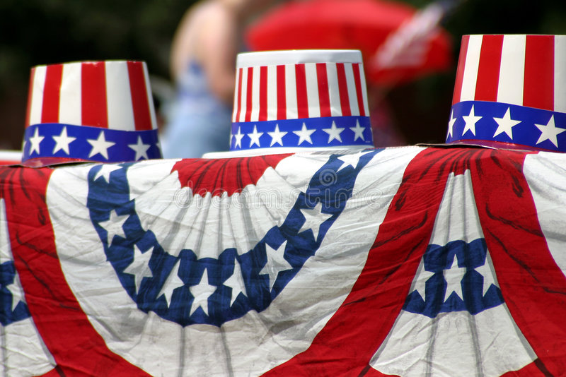 Hat's Off!. Patriotic, red-white-and-blue hats sit on a draped flag material during the Plano, Texas, Fourth of July parade in 2003