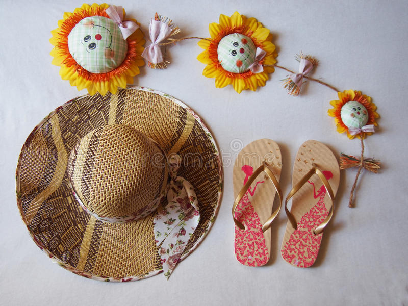 Hat sandals site sunflowers royalty free stock image