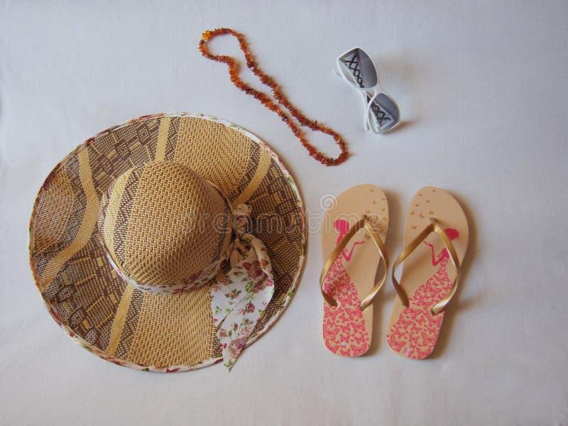 Hat sandals sunglasses jewelery royalty free stock photo