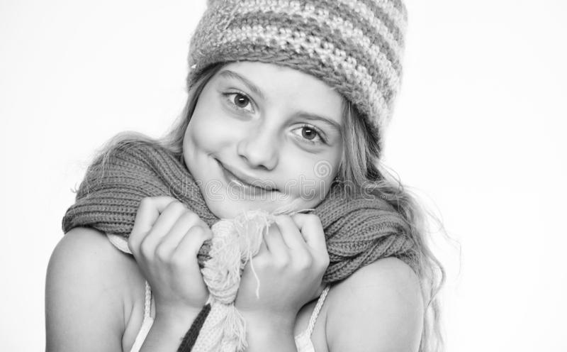 Hat and scarf keep warm. Kid wear warm soft knitted blue hat and long scarf. Warm woolen accessories. Girl long hair royalty free stock images